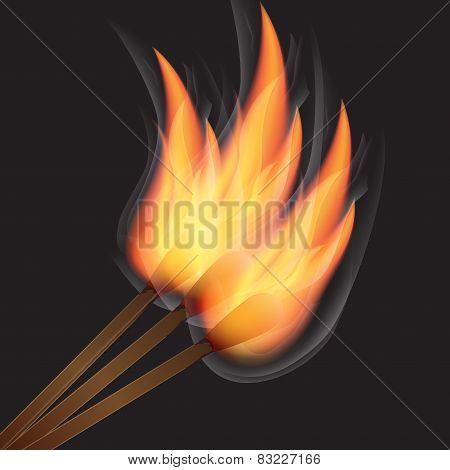 Three burning match on black background