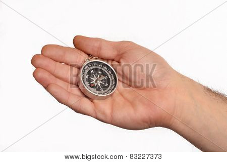 Hand holding a compass isolated on white background.
