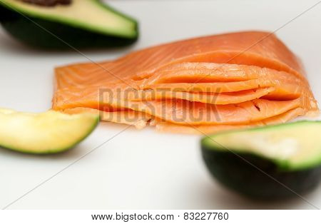 Fresh Salmon Fish With Avocado On White Table