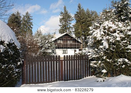 Wooden Cottage In Forest In Winter