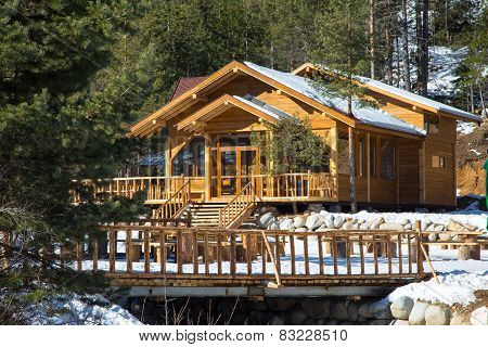 Wooden alpine chalet in the mountains
