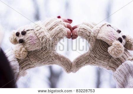 Hands In Gloves Making Heart Shape
