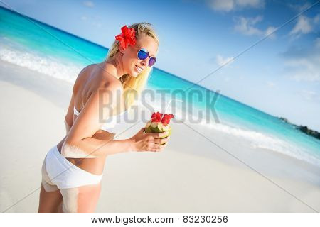 Young Woman Holding Fresh Cold Coconut At Tropical Beach