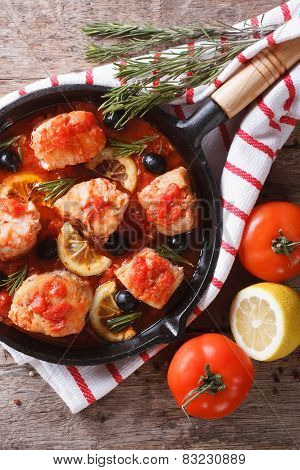 Fish In Tomato Sauce In A Frying Pan. Vertical Top View