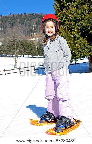 Little Girl With Snowshoes And The Helmet