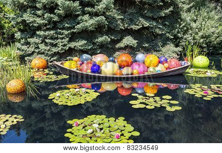 Bright Colored Glass Balls In Boat