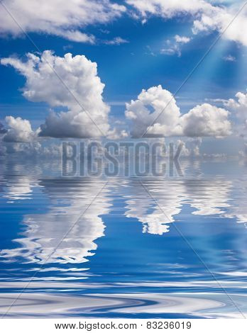Clouds reflections in blue water