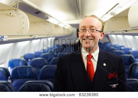 NEW-YORK, USA - APRIL 19, 2011: Delta Air Lines crew member in Boeing 757. Delta Air Lines, Inc. is a major American airline, with its headquarters and largest hub in Atlanta, Georgia