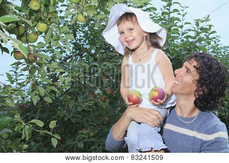 A girl and her daddy with apple background