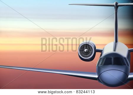 Passenger airliner flying at sunrise background.
