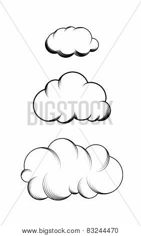 Set of hand drawn engraving clouds