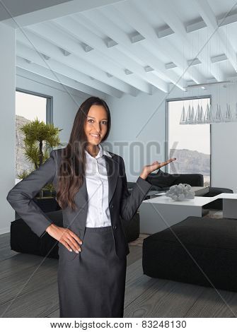 Close up Smiling Female Agent Showing the Architectural House Living Room. Background image is a 3d Rendering