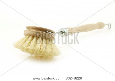 wooden dish washing brush on a white background