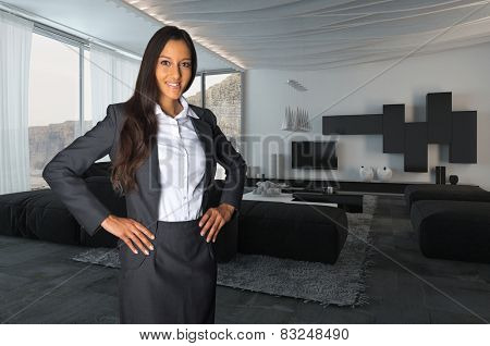 Close up Young Female Agent Posing at Architectural Living Room While Looking at the Camera. Background image is a 3d Rendering