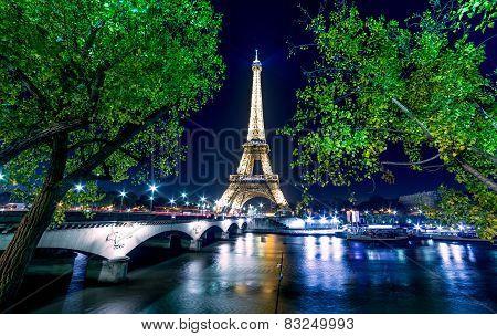 Paris Night Cityscape.  Eiffel Tower Light Show On Seine River