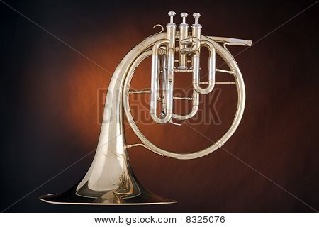 French Horn Antique Isolated On Gold