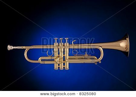 Gold Trumpet Isolated On Blue