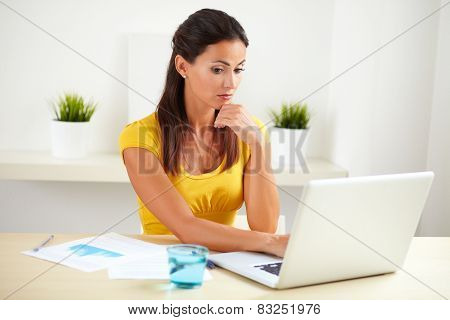 Lovely Female Employee Surfing The Web