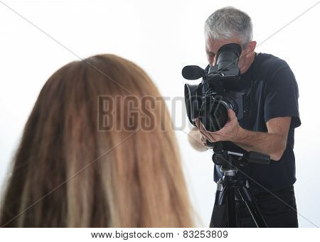 A camera man shooting a video for his company