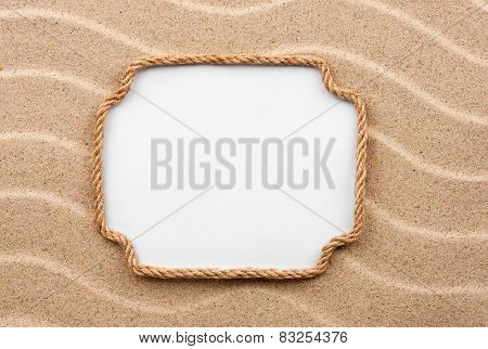Frame Made Of Rope With A White Background On The Sand