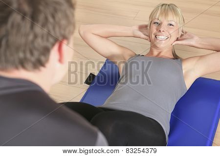 one caucasian couple man woman personal trainer coach exercising