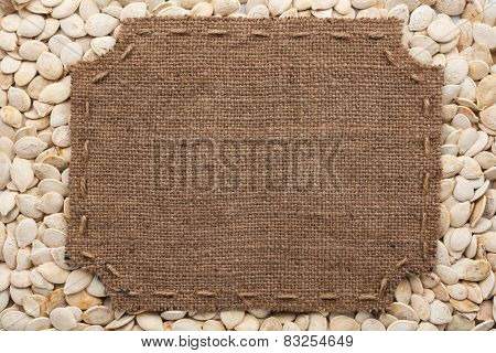 Frame Made Of Burlap With Stitches And Place For Your Text Lying On Pumpkin Seeds