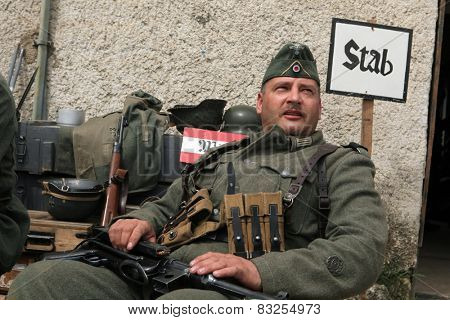 ORECHOV, CZECH REPUBLIC - APRIL 27, 2013: Re-enactor dressed as a German Nazi soldier prepares to stage the Battle at Orechov (1945) near Brno, Czech Republic.