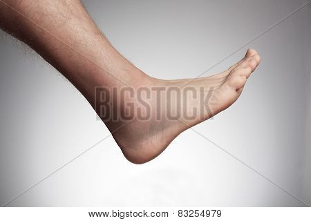 a men with a foot problem in front of a white background