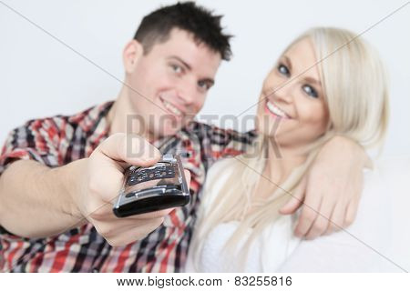 A couple in front of a big tv screen.
