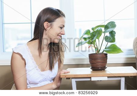A Woman look at  the Plants in the living room
