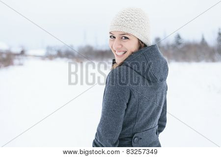 A Young woman outside in the winter season