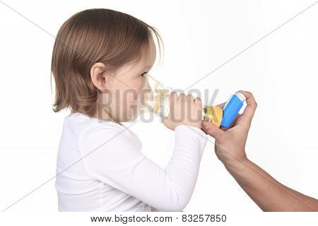 A mother giving in inhalator to a little girl