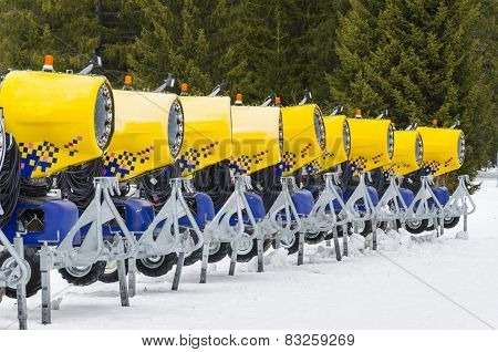 modern yellow cannons in raw for snow making
