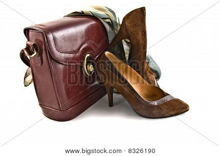 old shoes and bag on white background isolated