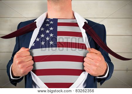 Businessman opening shirt to reveal usa flag against bleached wooden planks background