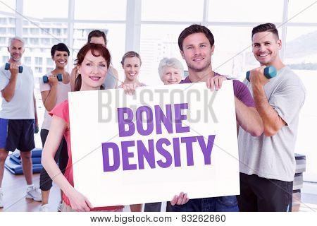 Couple holding a white sign against bone density