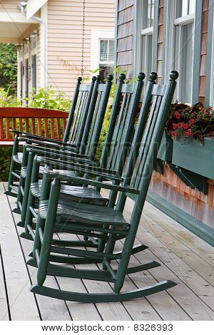 Four Green Rocking Chairs