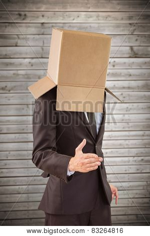 Anonymous businessman offering his hand against wooden planks background