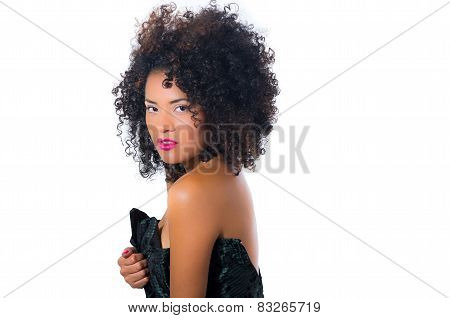 exotic beautiful young girl with dark curly hear posing