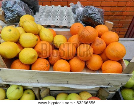Oranges And Lemons In Crates