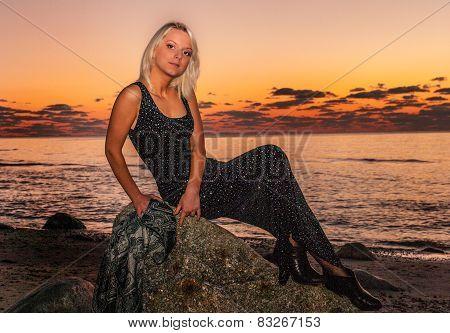 Fashion photo of sexy  blond girl on sunset beach