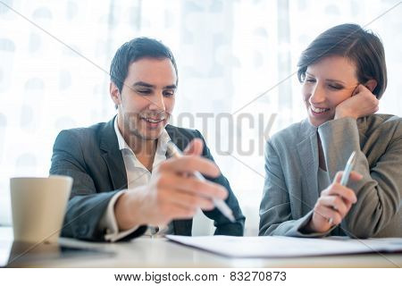 Businessman And Woman Working Together