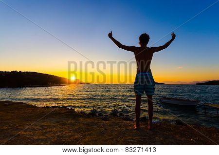 Man with raised hands, success concept