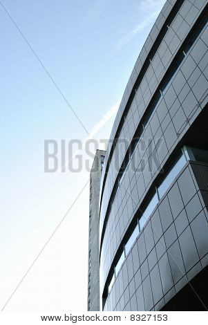 The modern edifice is against morning sky background