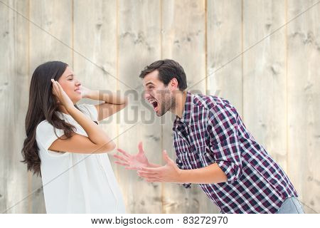 Fearful brunette being overpowered by boyfriend against pale wooden planks