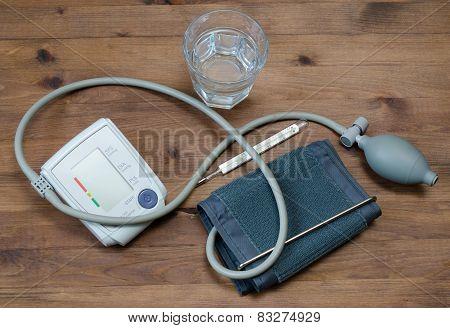 Water Glass, Tonometer, Thermometeron Table