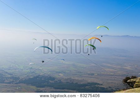 Paragliders above above mountain range