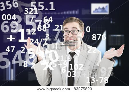 Geeky shrugging businessman biting calculator against business interface with graphs and data