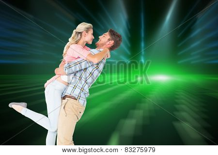 Handsome man picking up and hugging his girlfriend against cool nightlife lights