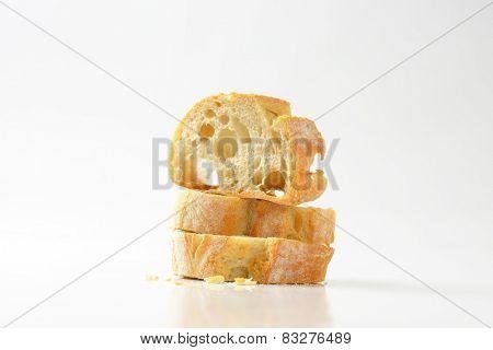three slices of white bread on white background